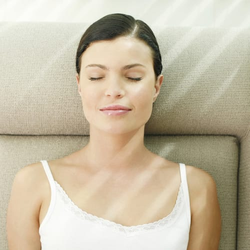 Woman with eyes closed during BWRT session